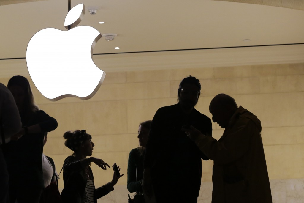 FILE- In this May 31, 2018, file photo customers enter the Apple store in New York. Apple is expected to unveil its biggest and most expensive iPhone
