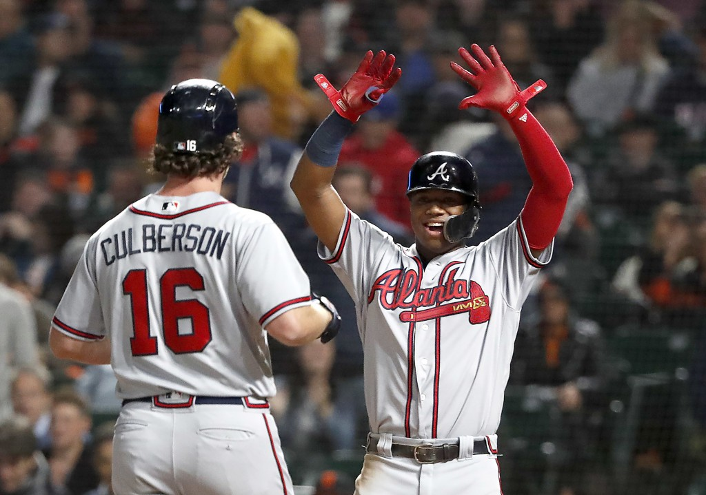 Atlanta Braves' Charlie Culberson (16) celebrates with teammate Ronald Acuna Jr., right, after hitting a two run home run against the San Francisco Gi