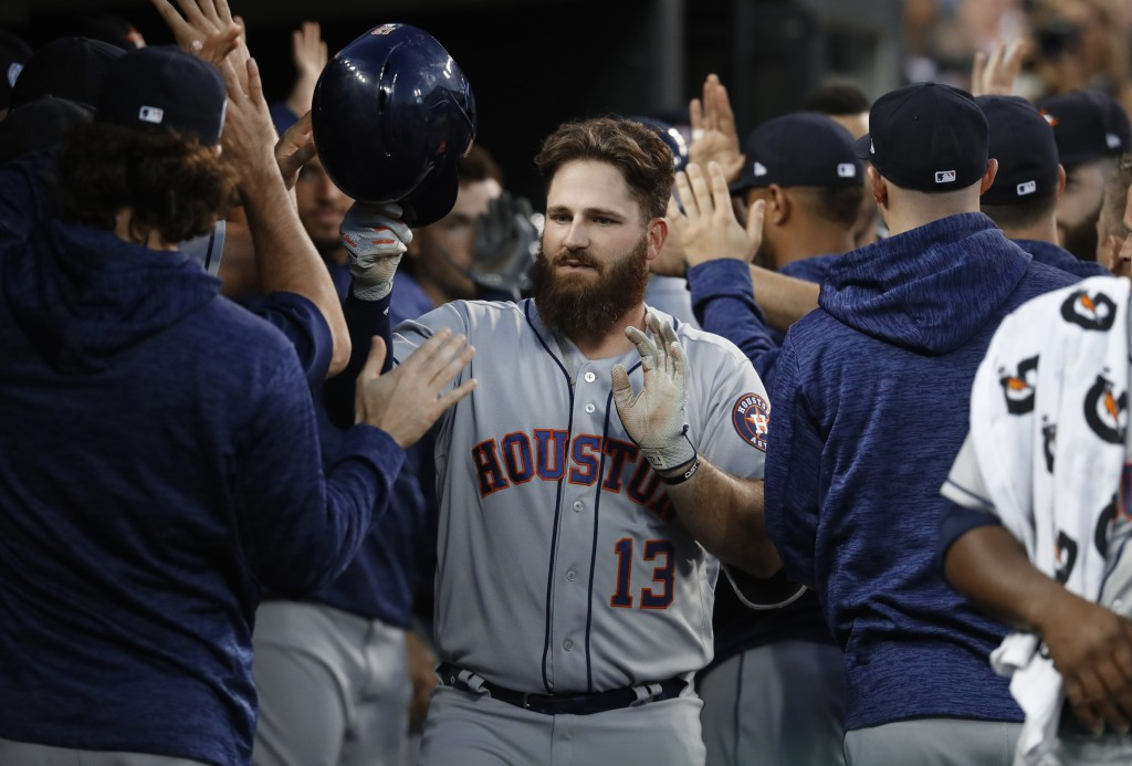 Houston Astros' Tyler White (13) celebrates his two-run home run in the fourth inning of a baseball game against the Detroit Tigers in Detroit, Tuesda