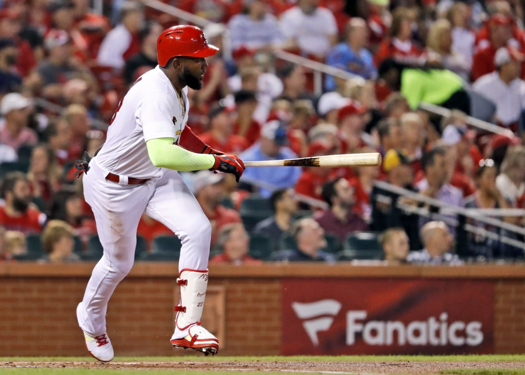 St. Louis Cardinals' Marcell Ozuna watches his two-run double during the first inning of a baseball game against the Pittsburgh Pirates, Tuesday, Sept