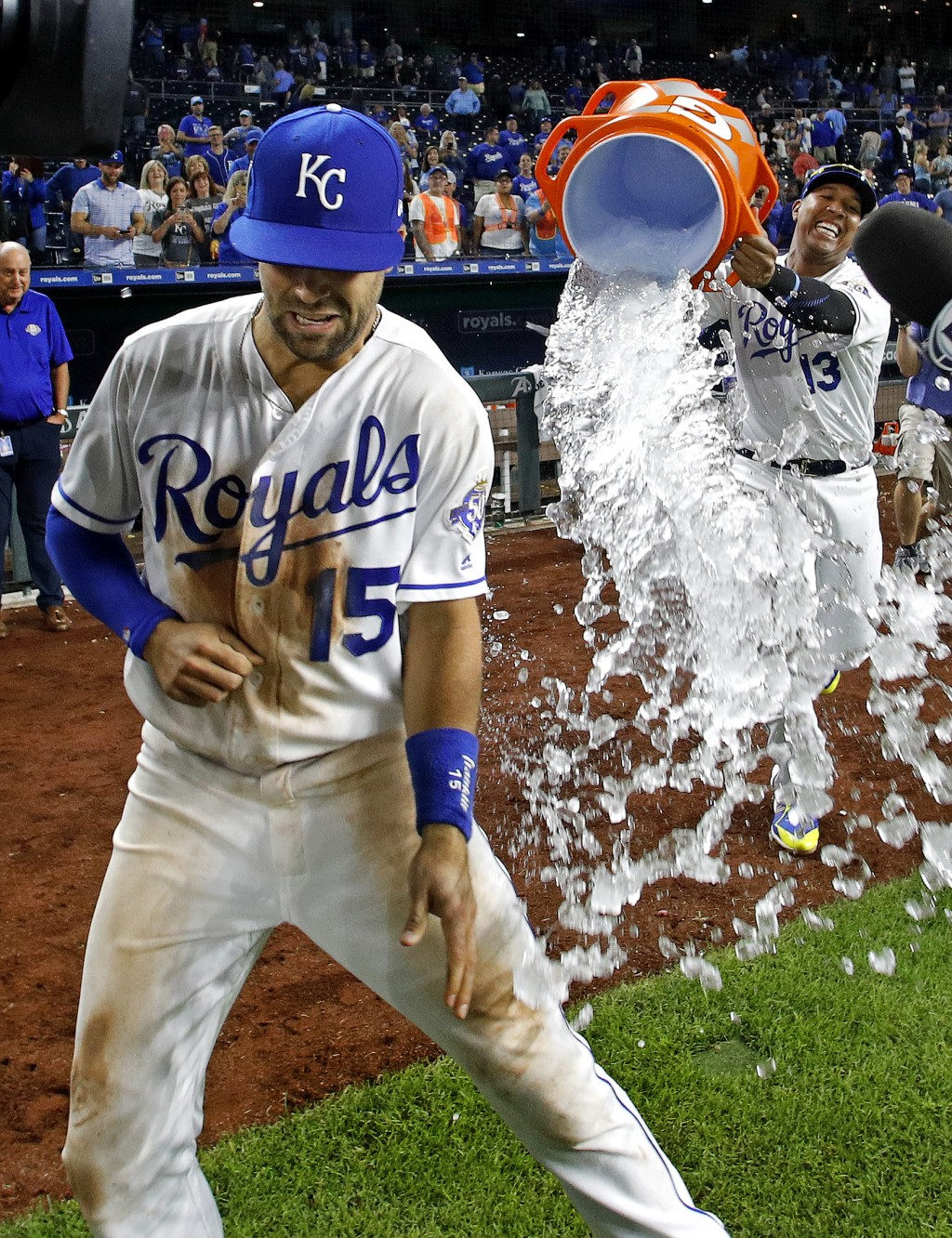 Kansas City Royals' Whit Merrifield (15) is doused by Salvador Perez (13) after their baseball game against the Chicago White Sox Tuesday, Sept. 11, 2