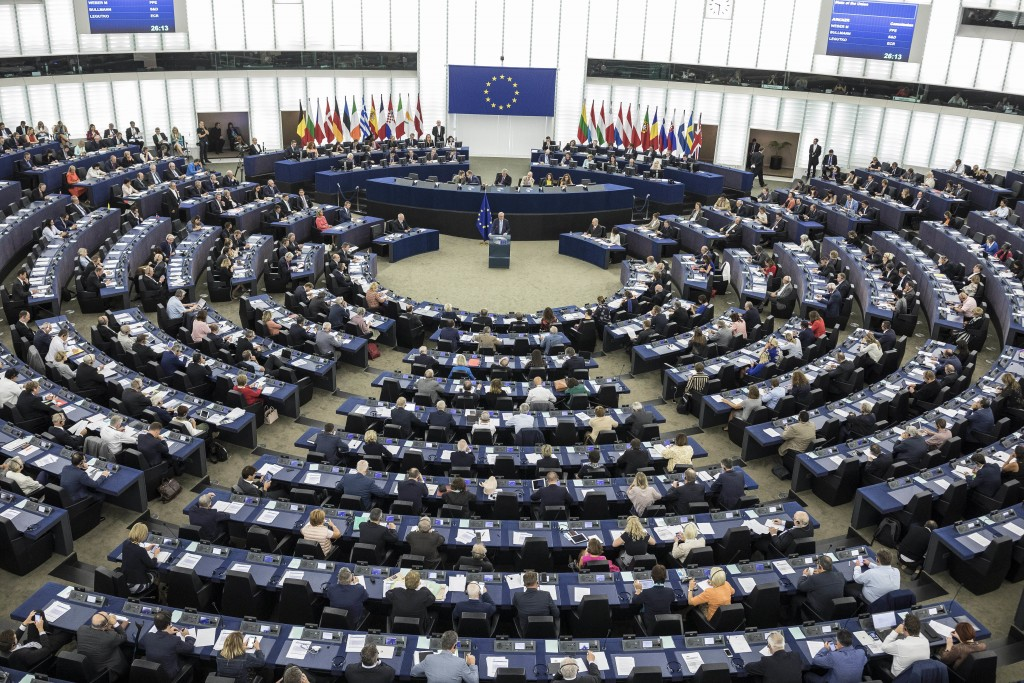 European Commission President Jean-Claude Juncker, center, delivers his State of Union speech at the European Parliament in Strasbourg, eastern France...
