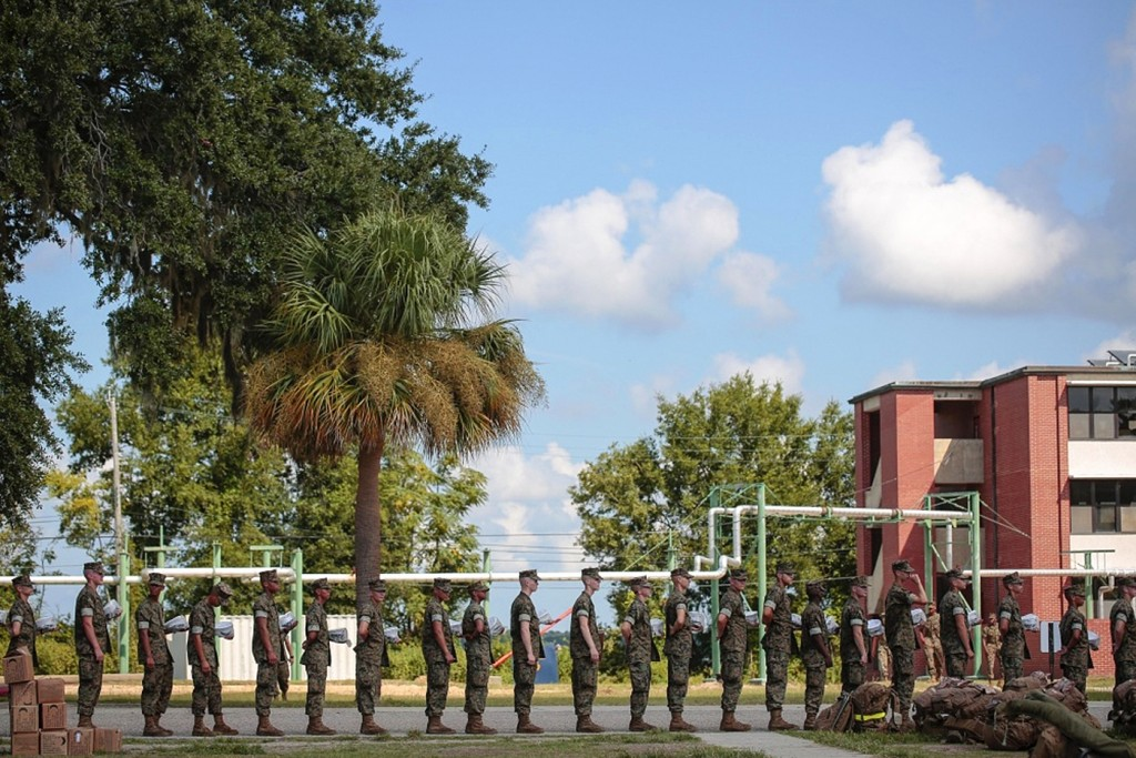 In this photo released by the U.S. Marine Corps, recruits at Marine Corps Recruit Depot Parris Island prepare to evacuate following an evacuation orde