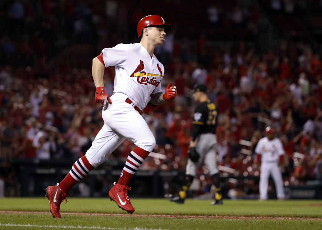 St. Louis Cardinals' Tyler O'Neill, left, rounds the bases after hitting a three-run home run off Pittsburgh Pirates relief pitcher Nick Burdi during
