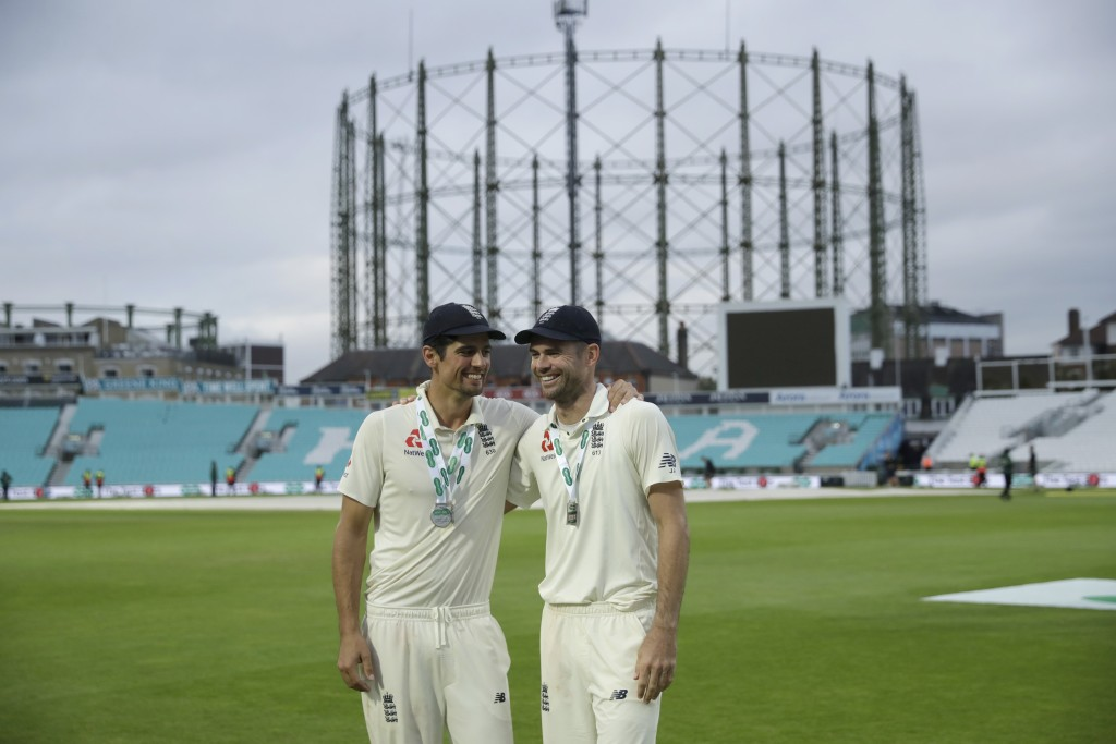 England's Alastair Cook, left, at the end of his last ever match before retiring from test cricket, and Jimmy Anderson who today broke the record for