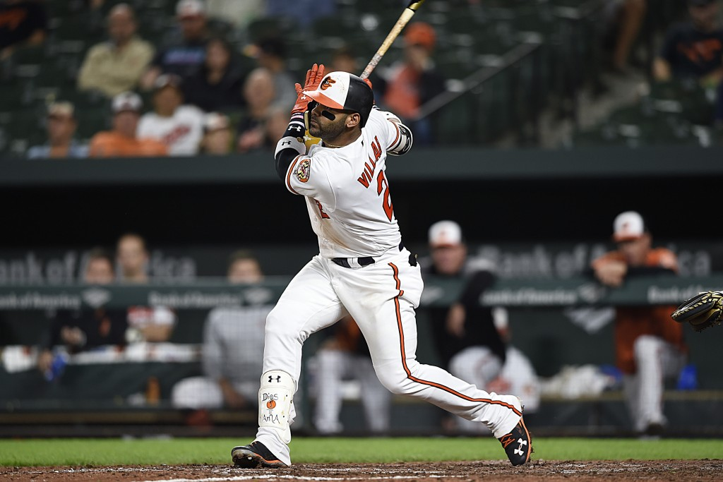Baltimore Orioles' Jonathan Villar follows through on an RBI single against the Oakland Athletics in the eighth inning of a baseball game, Tuesday, Se