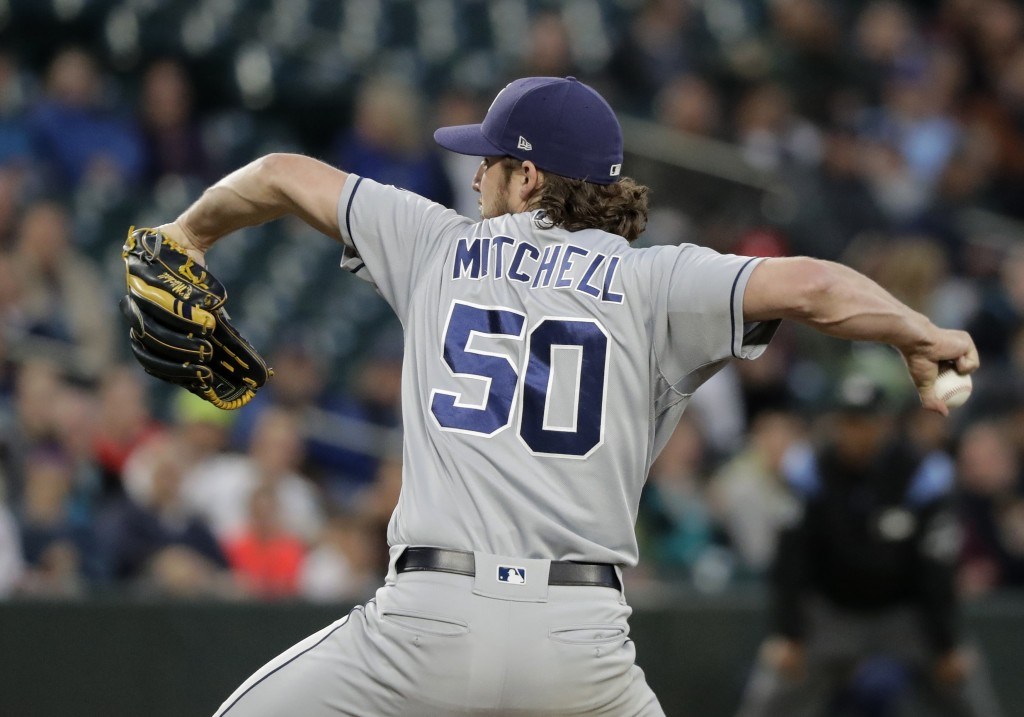 San Diego Padres starting pitcher Bryan Mitchell throws against the Seattle Mariners during the first inning of a baseball game, Tuesday, Sept. 11, 20