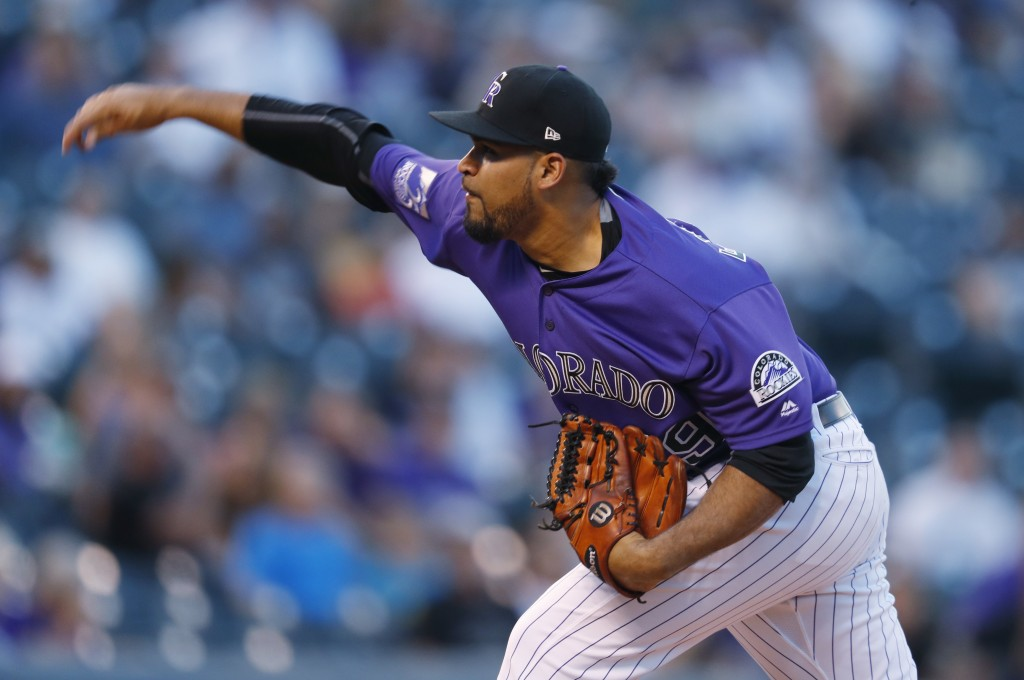 Colorado Rockies starting pitcher Antonio Senzatela works against the Arizona Diamondbacks in the first inning of a baseball game, Tuesday, Sept. 11,