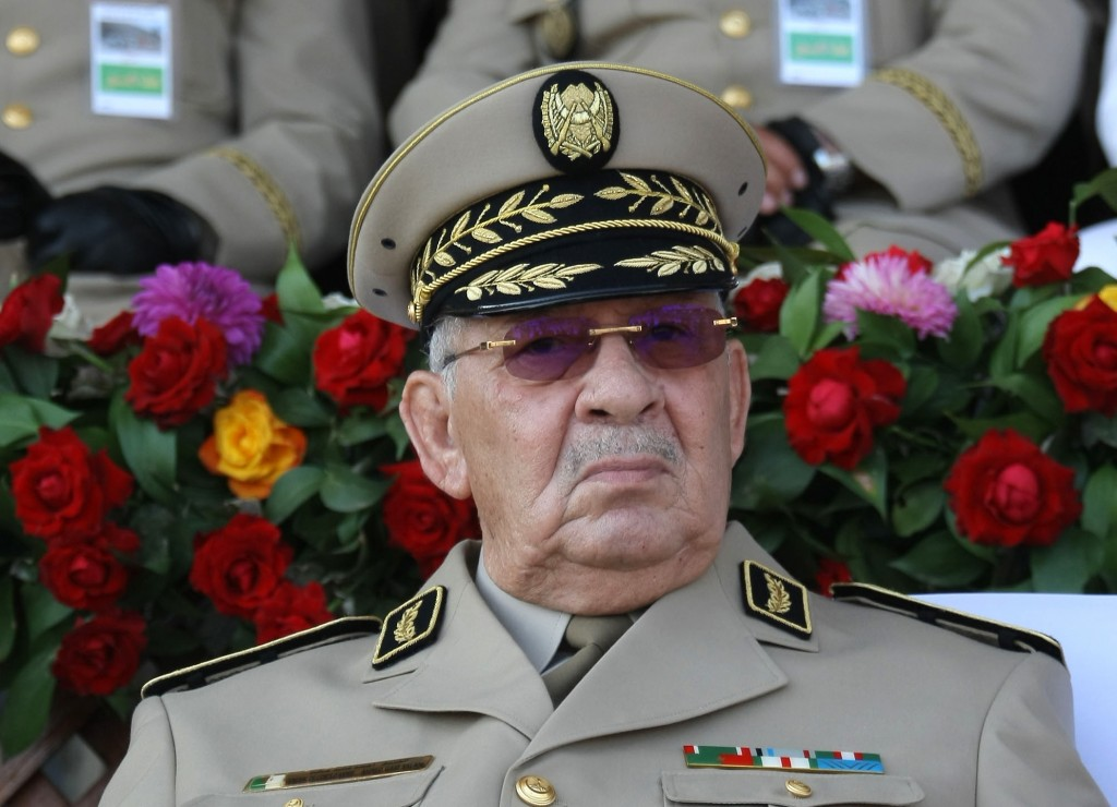 FILE - In this Sunday, July 1, 2018 file picture Algerian chief of staff Gen. Ahmed Gaid Salah presides a military parade in Algiers, Algeria. Heads h