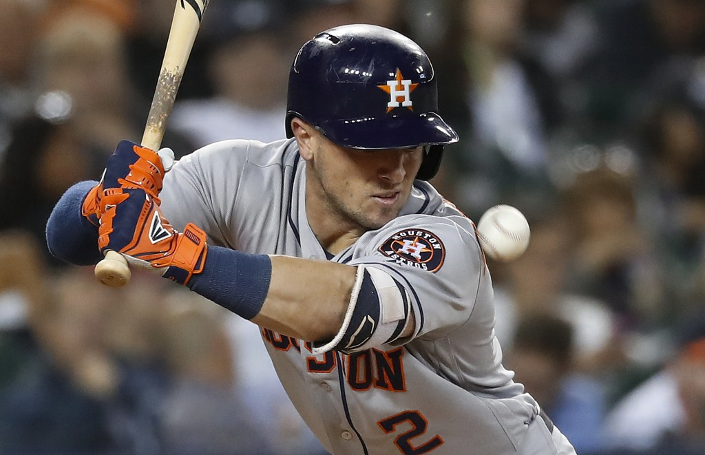 Houston Astros' Alex Bregman is hit by a pitch from Detroit Tigers pitcher Louis Coleman in the seventh inning of a baseball game in Detroit, Tuesday,