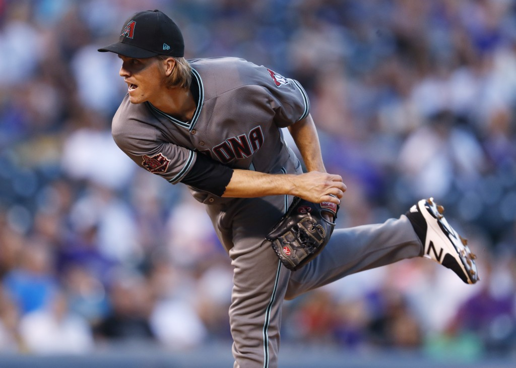 Arizona Diamondbacks starting pitcher Zack Greinke works against the Colorado Rockies in the first inning of a baseball game Tuesday, Sept. 11, 2018,