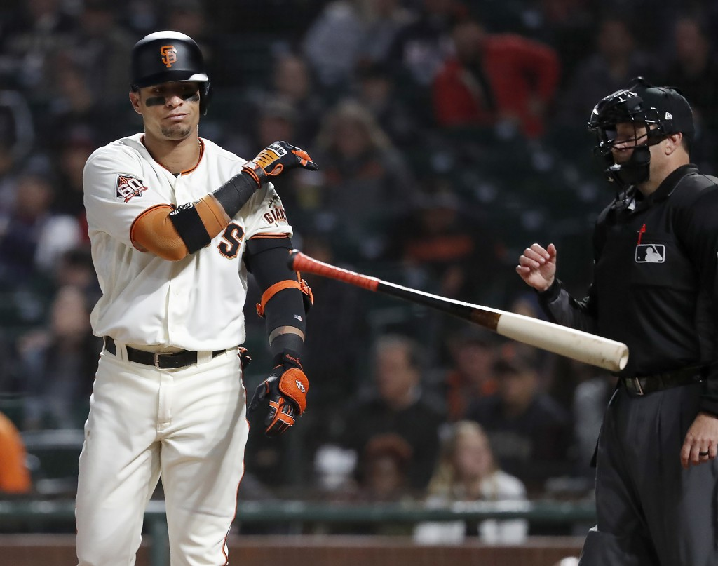 San Francisco Giants' Gorkys Hernandez throws his bat after striking out against the Atlanta Braves during the first inning of a baseball game in San