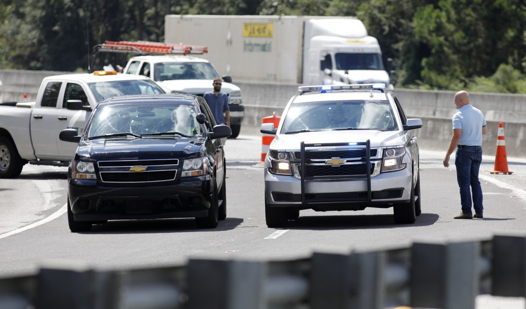 Police cars block the Ashley Phosphate Road exit ramp off Interstate 26 in North Charleston, S.C., as both sides of the highway flow westbound toward