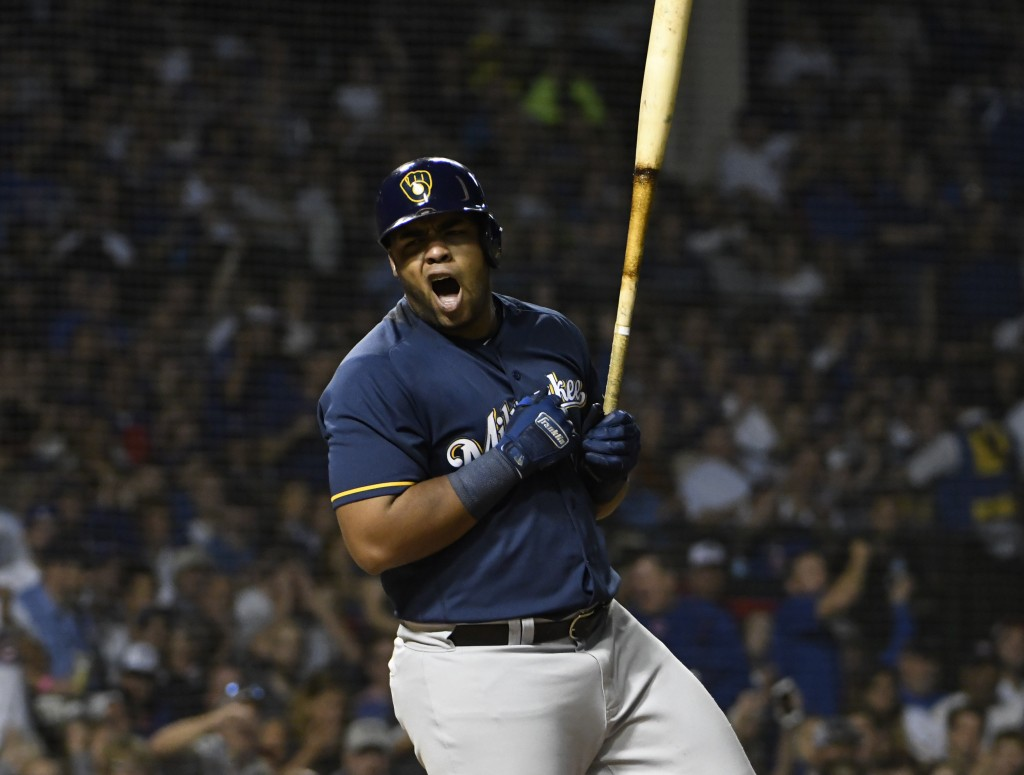 Milwaukee Brewers' Jesus Aguilar (24) reacts after being called out on strikes against the Chicago Cubs during the fourth inning of a baseball game, T