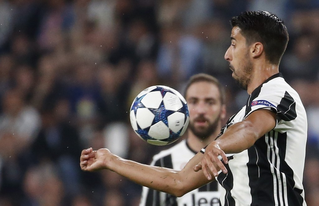 FILE - In this April 11, 2017 file photo, Juventus's Sami Khedira goes for the ball during a Champions League match between Juventus and Barcelona, at