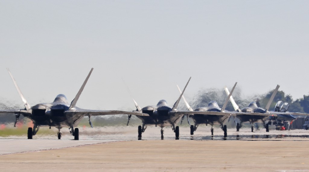 F-22s taxi down the runway as they prepare to depart Langley Air Force Base, Va., Tuesday morning, Sept. 11, 2018, as Hurricane Florence approaches th