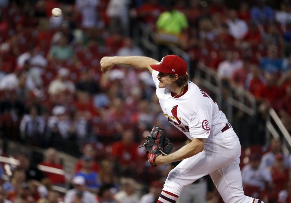 St. Louis Cardinals starting pitcher Miles Mikolas throws during the first inning of a baseball game against the Pittsburgh Pirates Tuesday, Sept. 11,