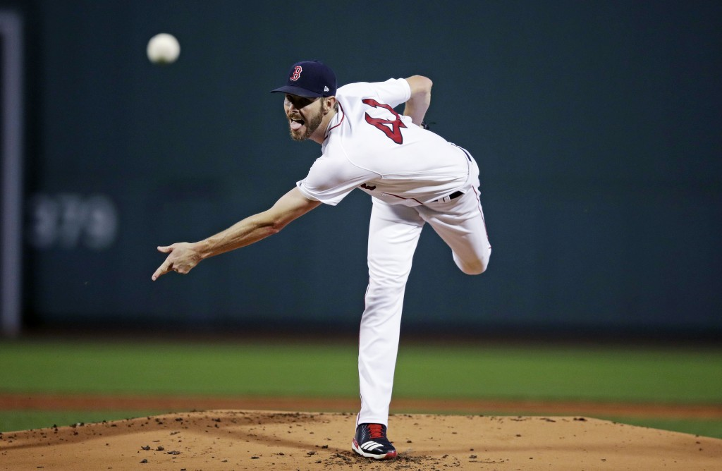 Boston Red Sox starting pitcher Chris Sale delivers during the first inning of a baseball game against the Toronto Blue Jays at Fenway Park in Boston,