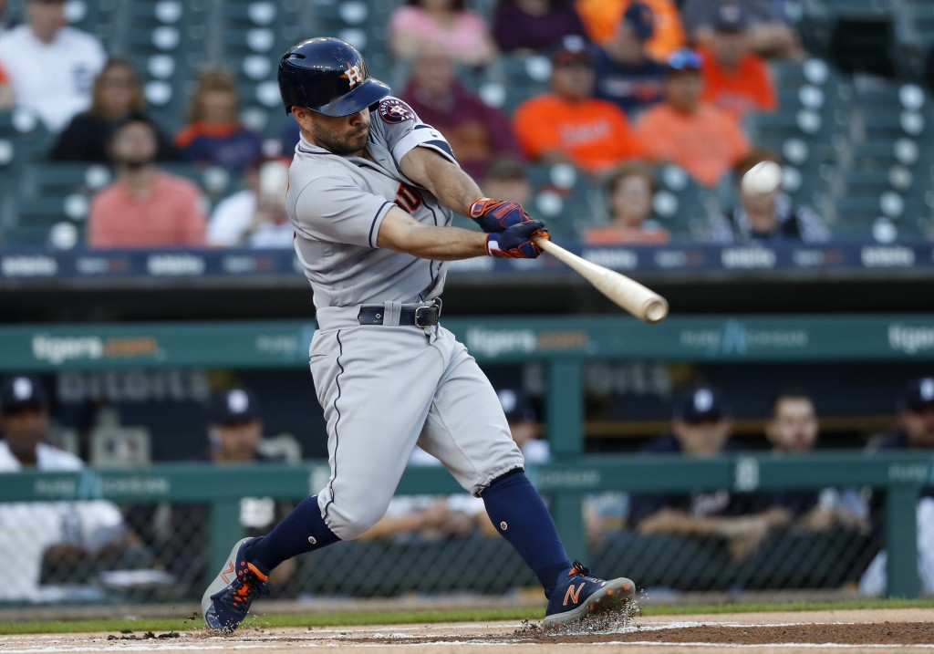 Houston Astros' Jose Altuve hits a leadoff solo home run against the Detroit Tigers in the first inning of a baseball game in Detroit, Tuesday, Sept.
