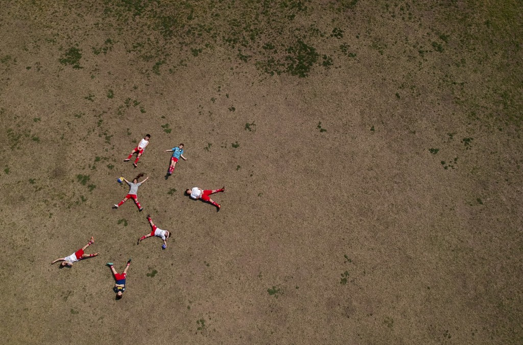 In this Sept. 8, 2018 photo, Candelaria Cabrera poses for a photo with her Huracan soccer club teammates in Chabaz, Argentina. Printed on the back of