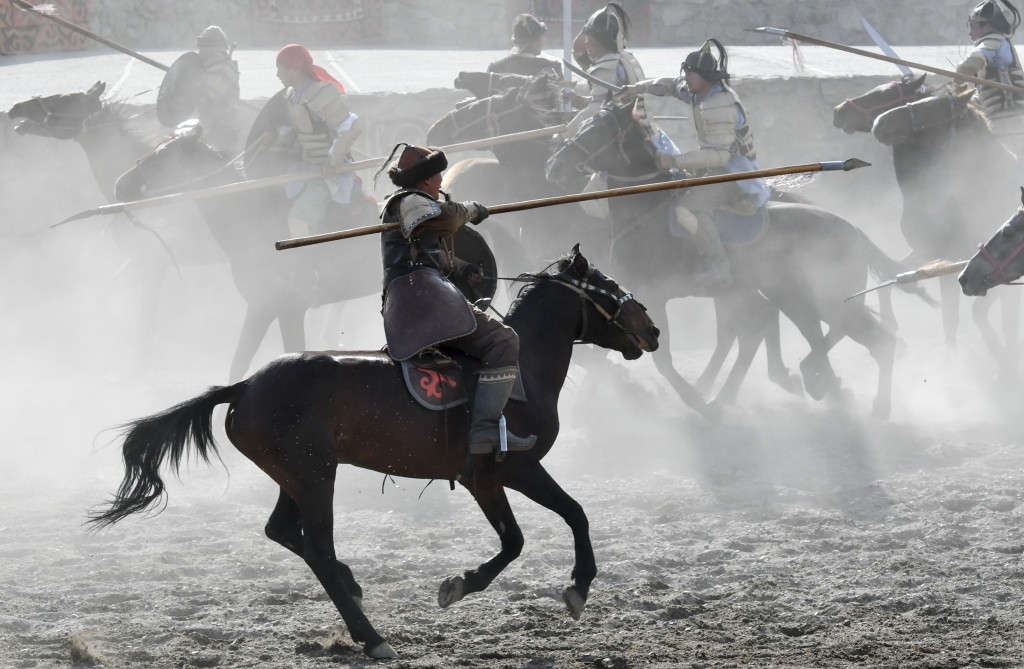 In this photo taken on Monday, Sept. 3, 2018, participants take part in a horse-riding competition during the Third World Nomad Games, in Cholpon-Ata,