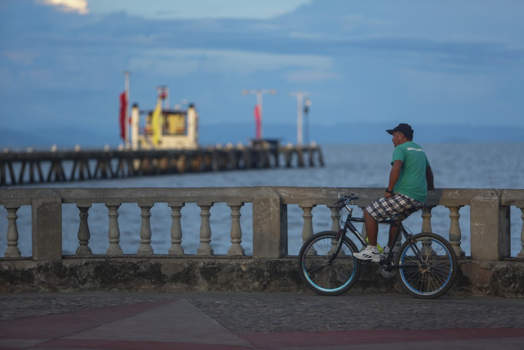 A man looks out into lake Nicaragua and sunset in the colonial city of Granada, Nicaragua, Monday, Sept. 10, 2018. Nicaragua's economy has been devast