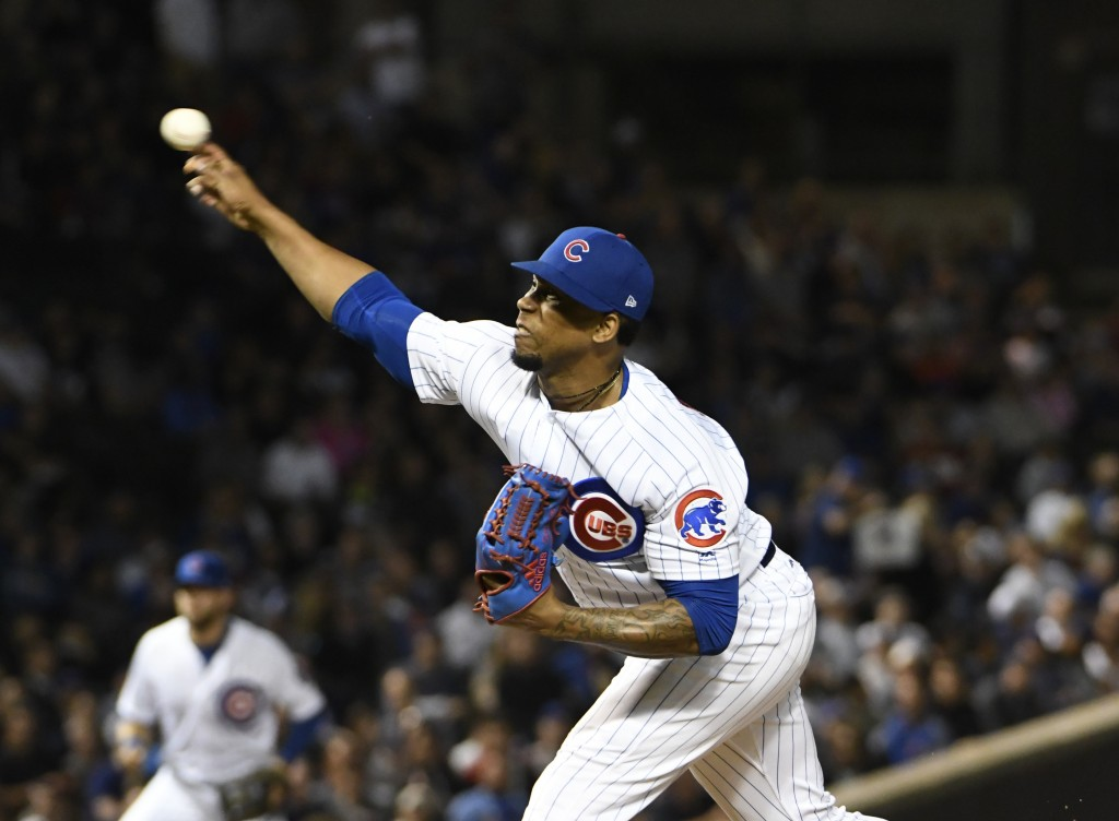 Chicago Cubs relief pitcher Pedro Strop (46) throws the ball against the Milwaukee Brewers during the ninth inning of a baseball game, Tuesday, Sept.