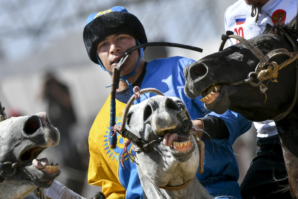In this photo taken on Wednesday, Sept. 5, 2018, a Kazakh horse rider competes for the goat during a kok boru, also called ulak tartysh match between