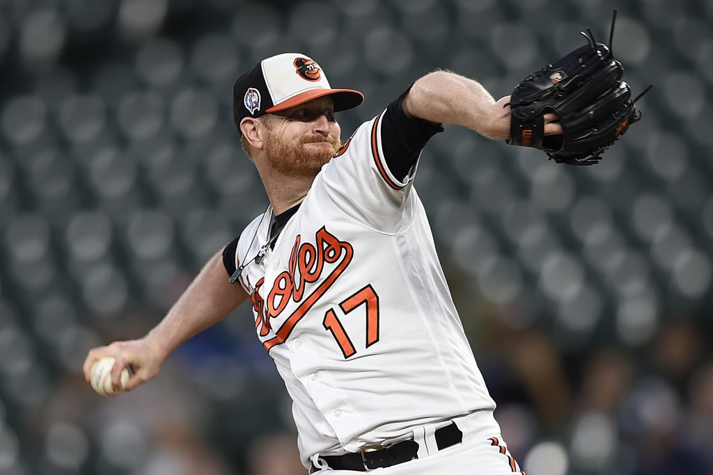 Baltimore Orioles pitcher Alex Cobb throws against the Oakland Athletics in the first inning of a baseball game, Tuesday, Sept. 11, 2018, in Baltimore