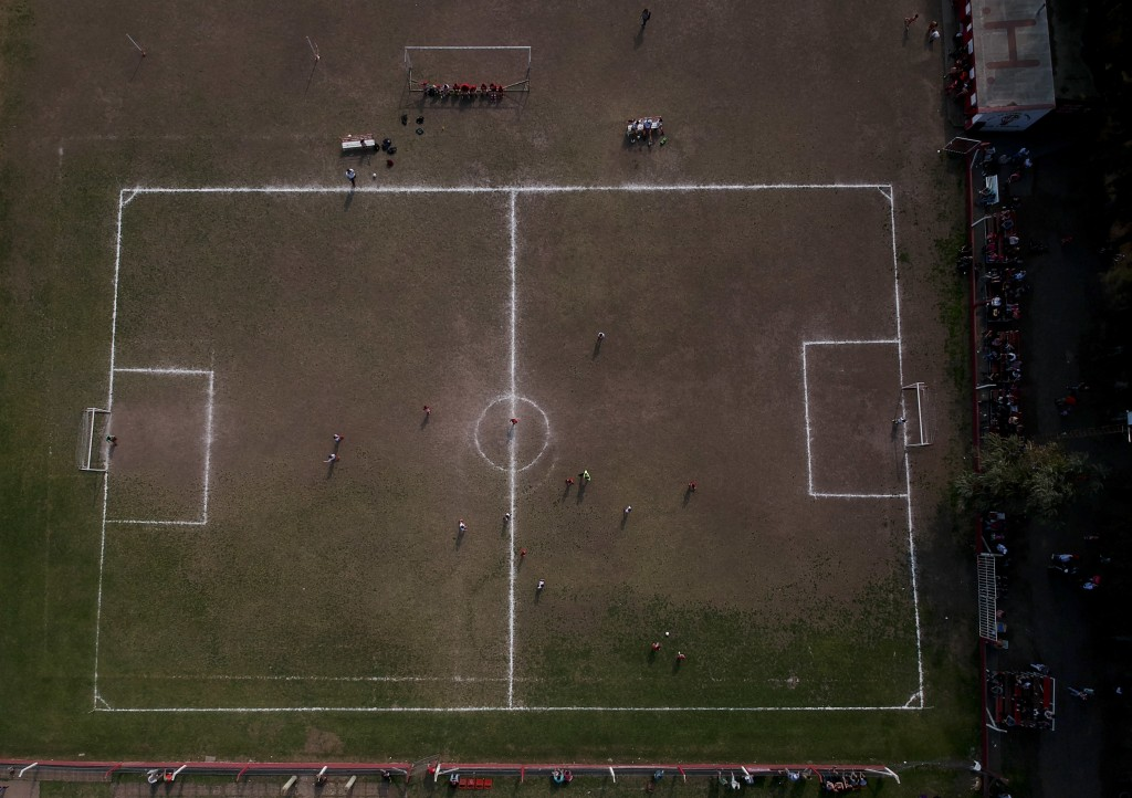 In this Sept. 8, 2018 photo, the Huracan de Chabas plays against Alumni, in Chabaz, Argentina. Two months ago, the regional soccer authorities notifie
