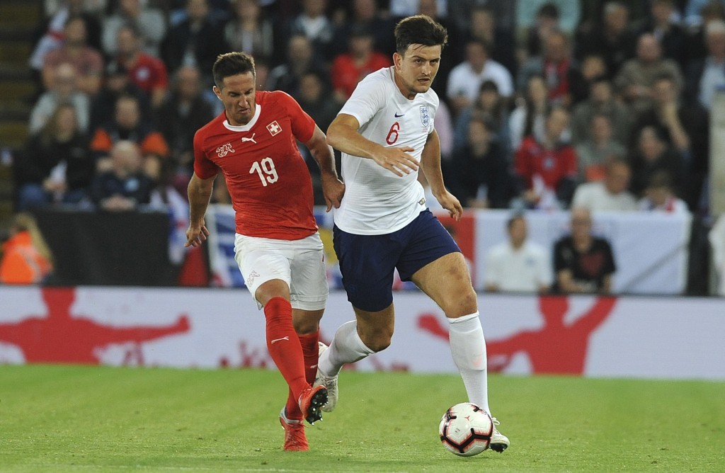 Switzerland's Mario Gavranovic, left, and England's Harry Maguire challenge for the ball during the International friendly soccer match between Englan
