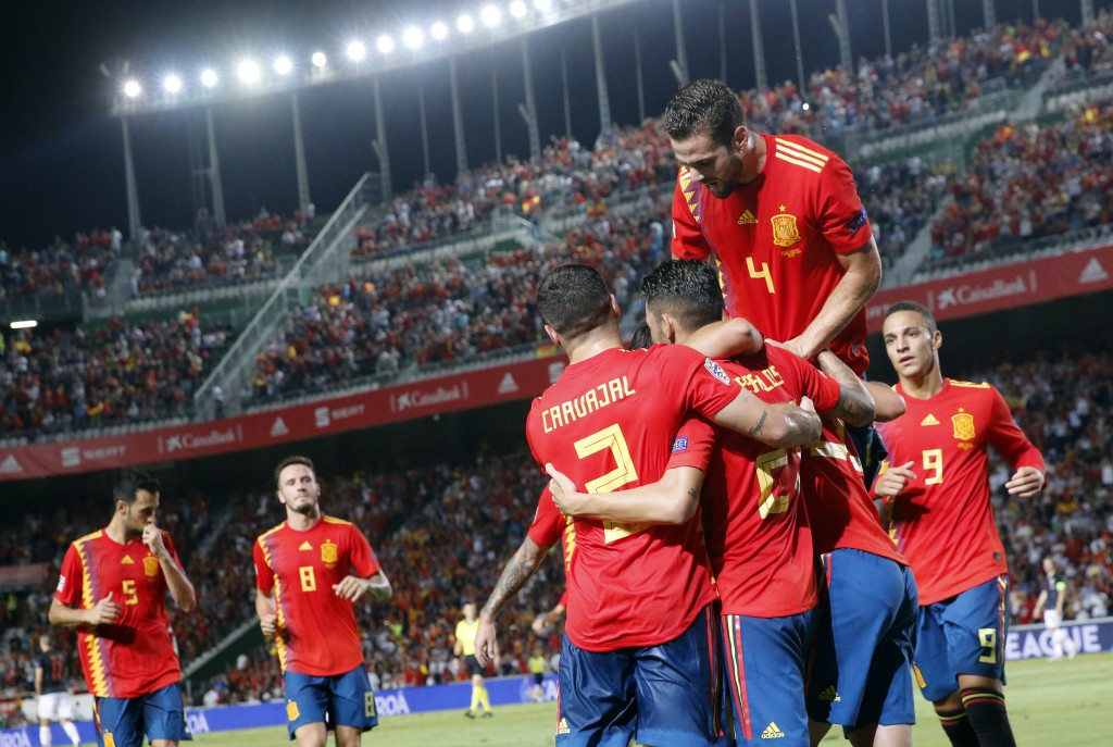 Spain's Sergio Ramos celebrates with teammates after scoring his side's fifth goal during the UEFA Nations League soccer match between Spain and Croat