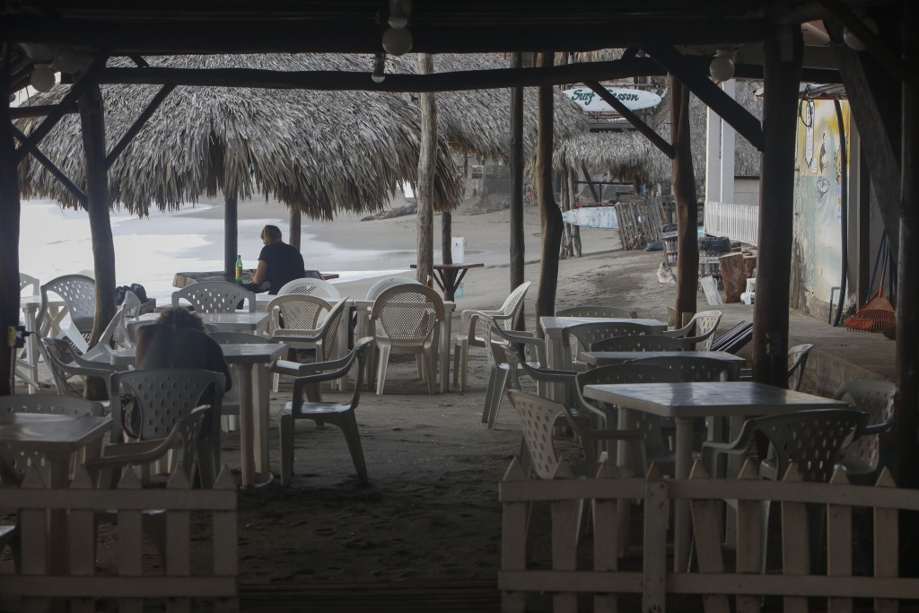 A few visitors visit a beachside restaurant in the coastal town of Las Peñitas, Nicaragua, Tuesday, Sept. 11, 2018. Economists estimate that since the