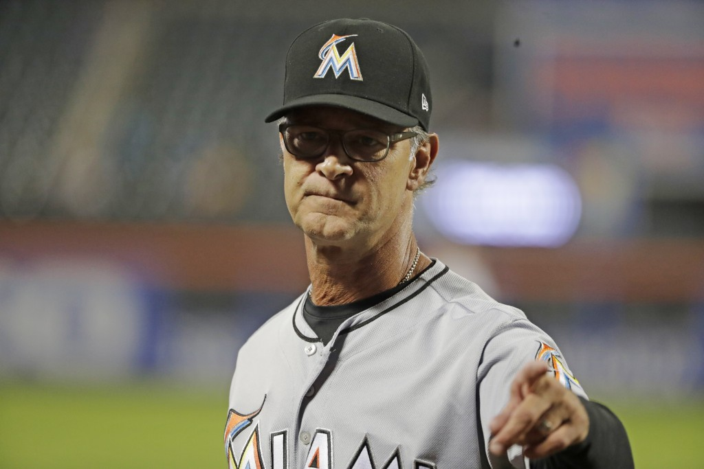 Miami Marlins manager Don Mattingly gestures after a pitching change during the seventh inning of a baseball game against the New York Mets, Tuesday,
