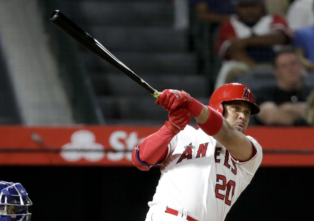 Los Angeles Angels' Jose Fernandez watches his home run against the Texas Rangers during the second inning of a baseball game in Anaheim, Calif., Tues