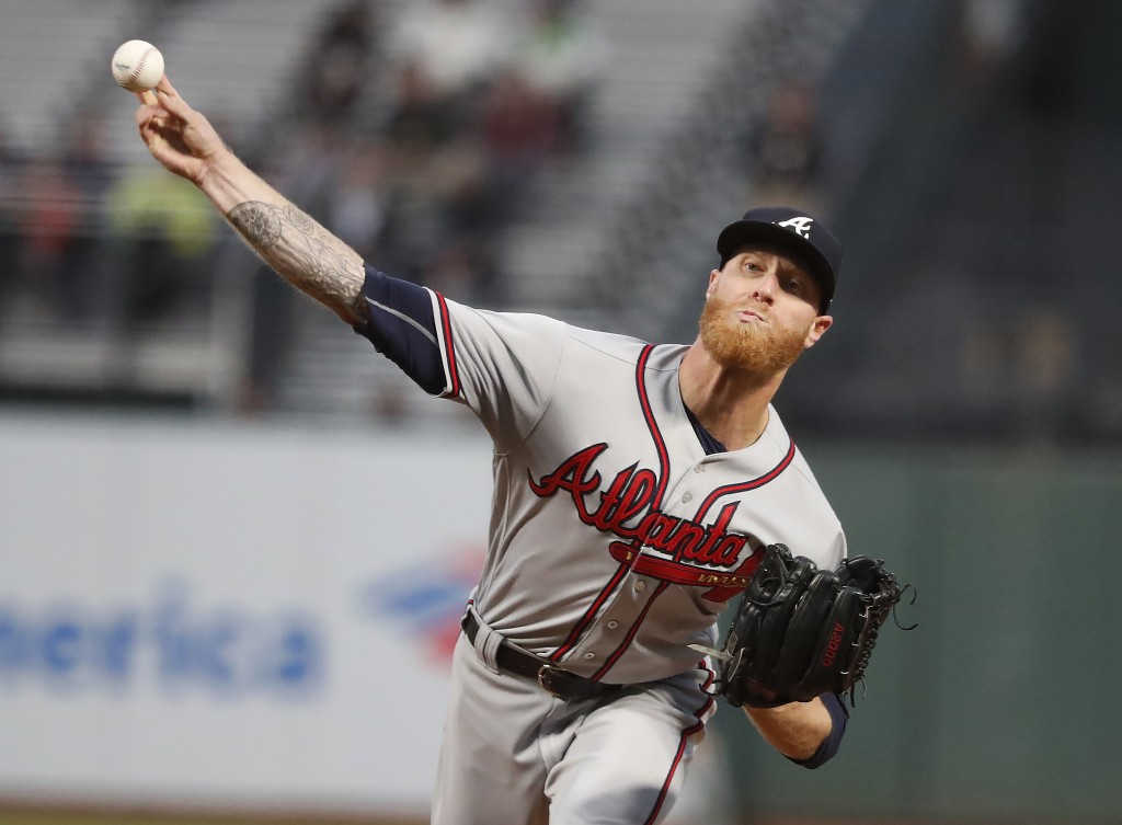 Atlanta Braves starting pitcher Mike Foltynewicz (26) throws against the San Francisco Giants during the first inning of a baseball game in San Franci