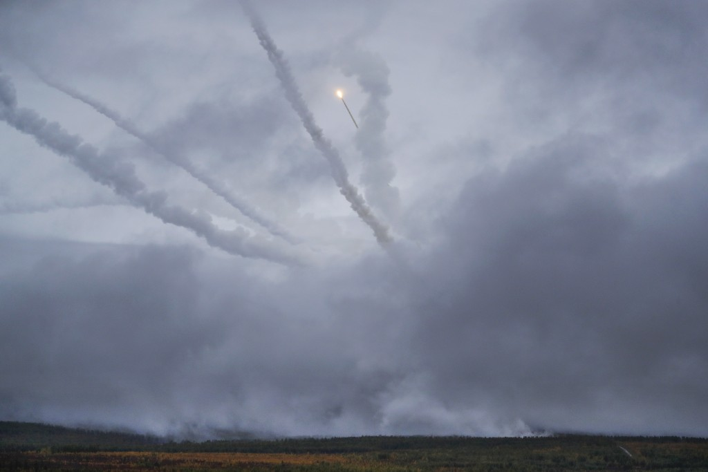 """An air defense missile system flies during a military exercises on training ground """"Telemba"""", about 80 kilometers (50 miles ) north of the city of Chi"""