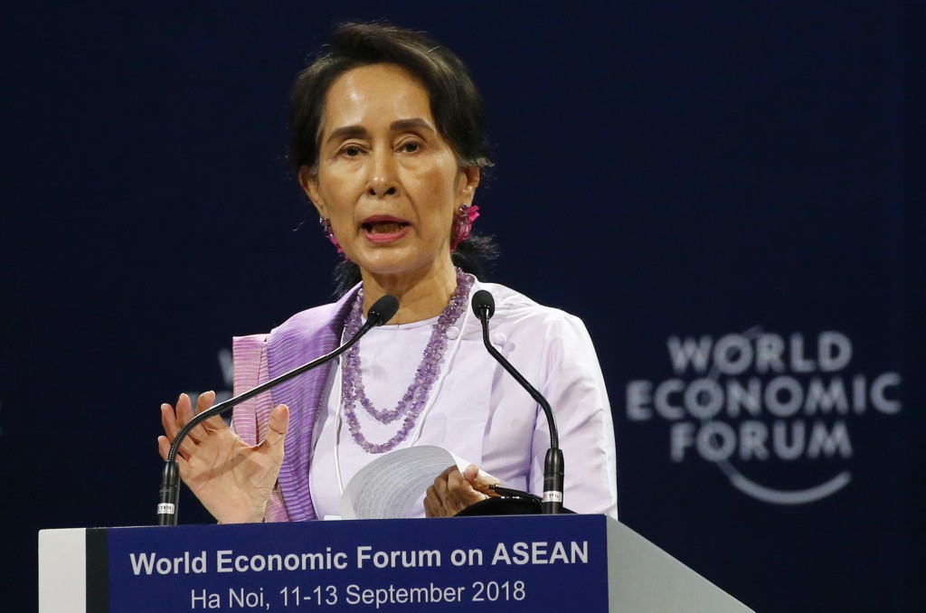 Myanmar leader Aung San Suu Kyi addresses participants during the opening session of the World Economic Forum on ASEAN Wednesday, Sept. 12, 2018 in Ha