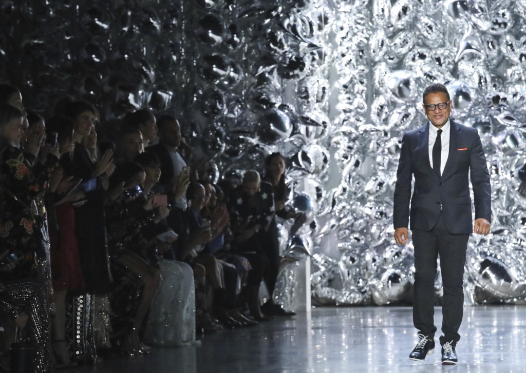 Fashion designer Naeem Khan appears after showing his latest collection during Fashion Week, Tuesday Sept. 11, 2018 in New York. (AP Photo/Bebeto Matt