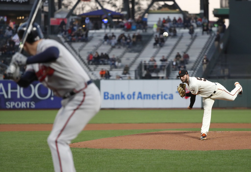San Francisco Giants starting pitcher Andrew Suarez (59) throws against the Atlanta Braves during the first inning of a baseball game in San Francisco