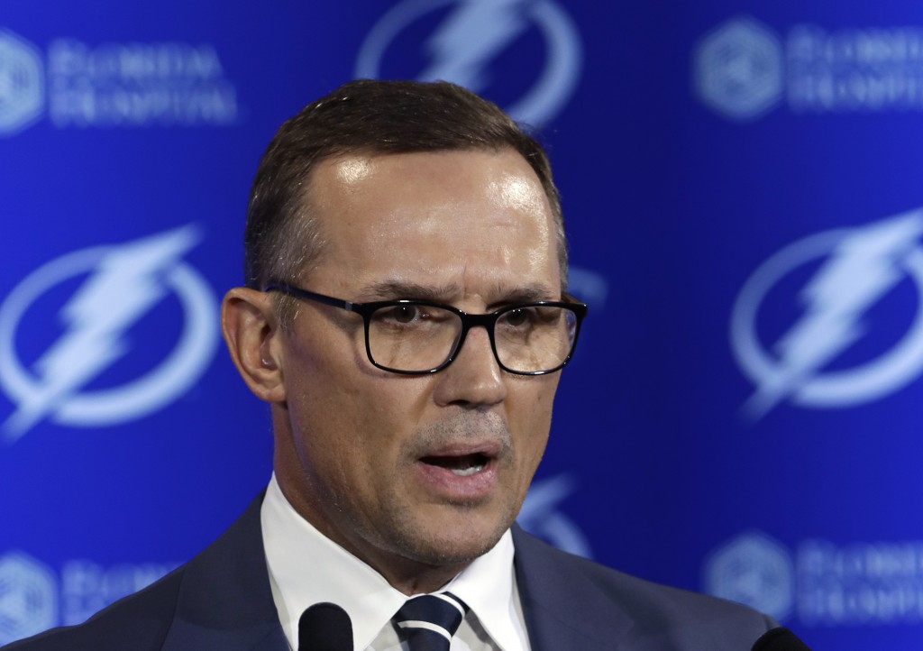 FILE - In this Feb. 26, 2018, file photo, Tampa Bay Lightning general manager Steve Yzerman gestures during a news conference before an NHL hockey gam