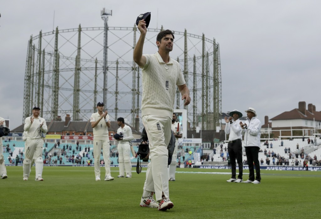 England's Alastair Cook, at the end of his last ever match before retiring from test cricket, raises his cap as he walks off at the end of the fifth c