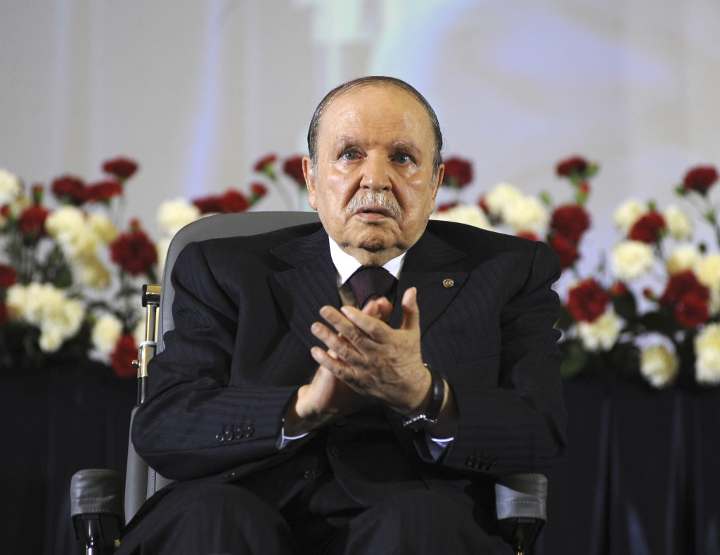 FILE - In this April 28, 2014 file photo, Algerian President Abdelaziz Bouteflika, sitting in a wheelchair, applauds after taking the oath as Presiden