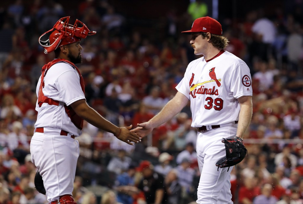 St. Louis Cardinals starting pitcher Miles Mikolas, right, and catcher Francisco Pena celebrate after working the top of sixth inning of a baseball ga