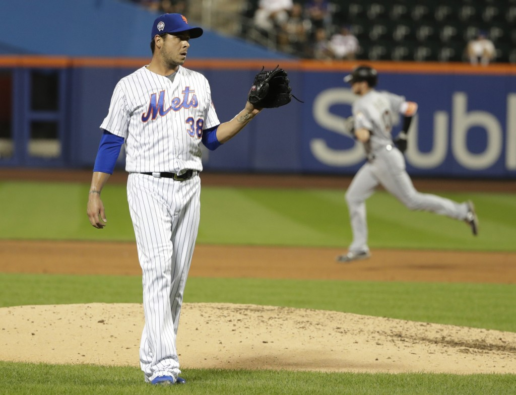 New York Mets relief pitcher Anthony Swarzak (38) reacts as Miami Marlins' JT Riddle (10) runs the bases after hitting a home run during the eighth in