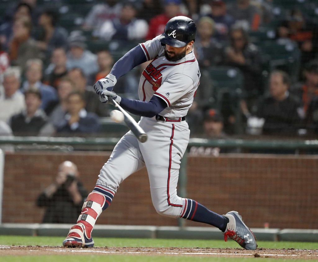 Atlanta Braves' Nick Markakis (22) hits a single against the San Francisco Giants during the second inning of a baseball game in San Francisco, Tuesda