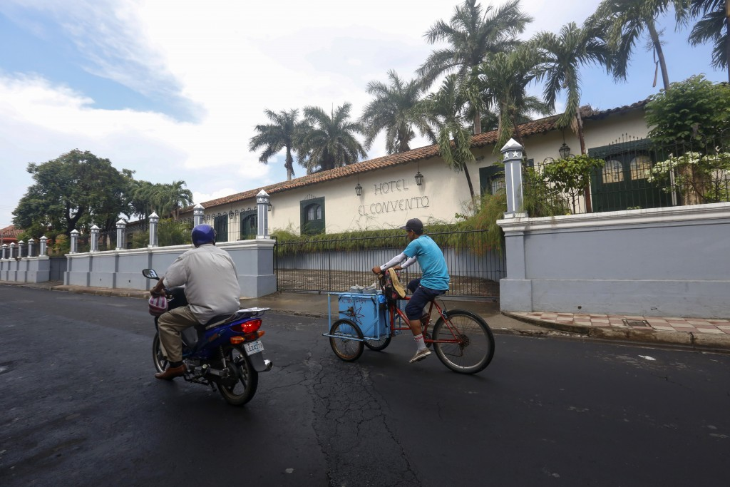 Traffic drives past the El Convento hotel, in Leon, Nicaragua, Tuesday, Sept. 11, 2018. When protests began in April, a foreign auto components compan