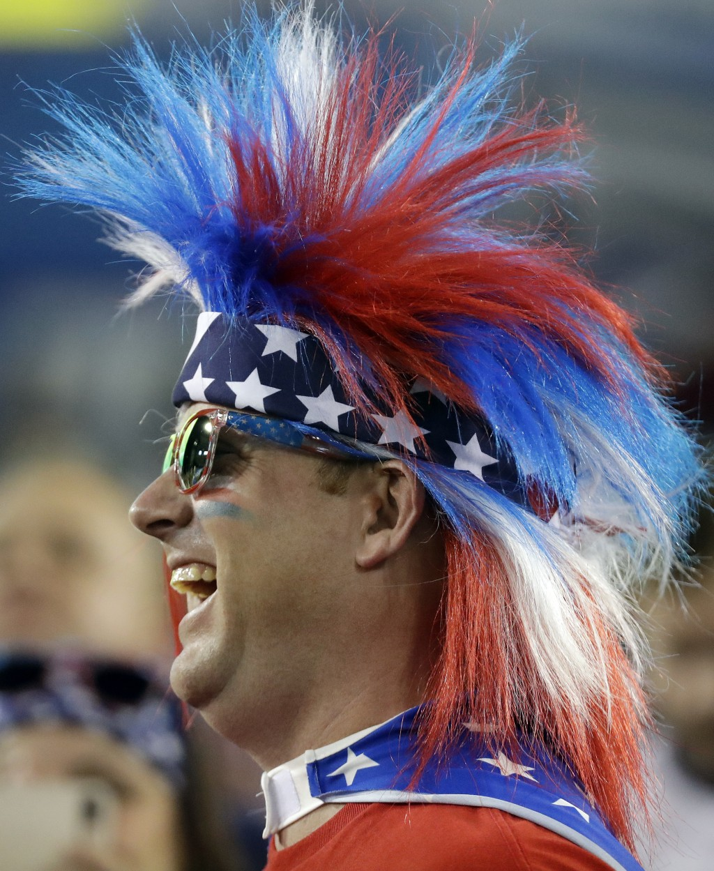 A fan of the U.S. men's national soccer team team cheers during an international friendly match against Mexico, Tuesday, Sept. 11, 2018, in Nashville,
