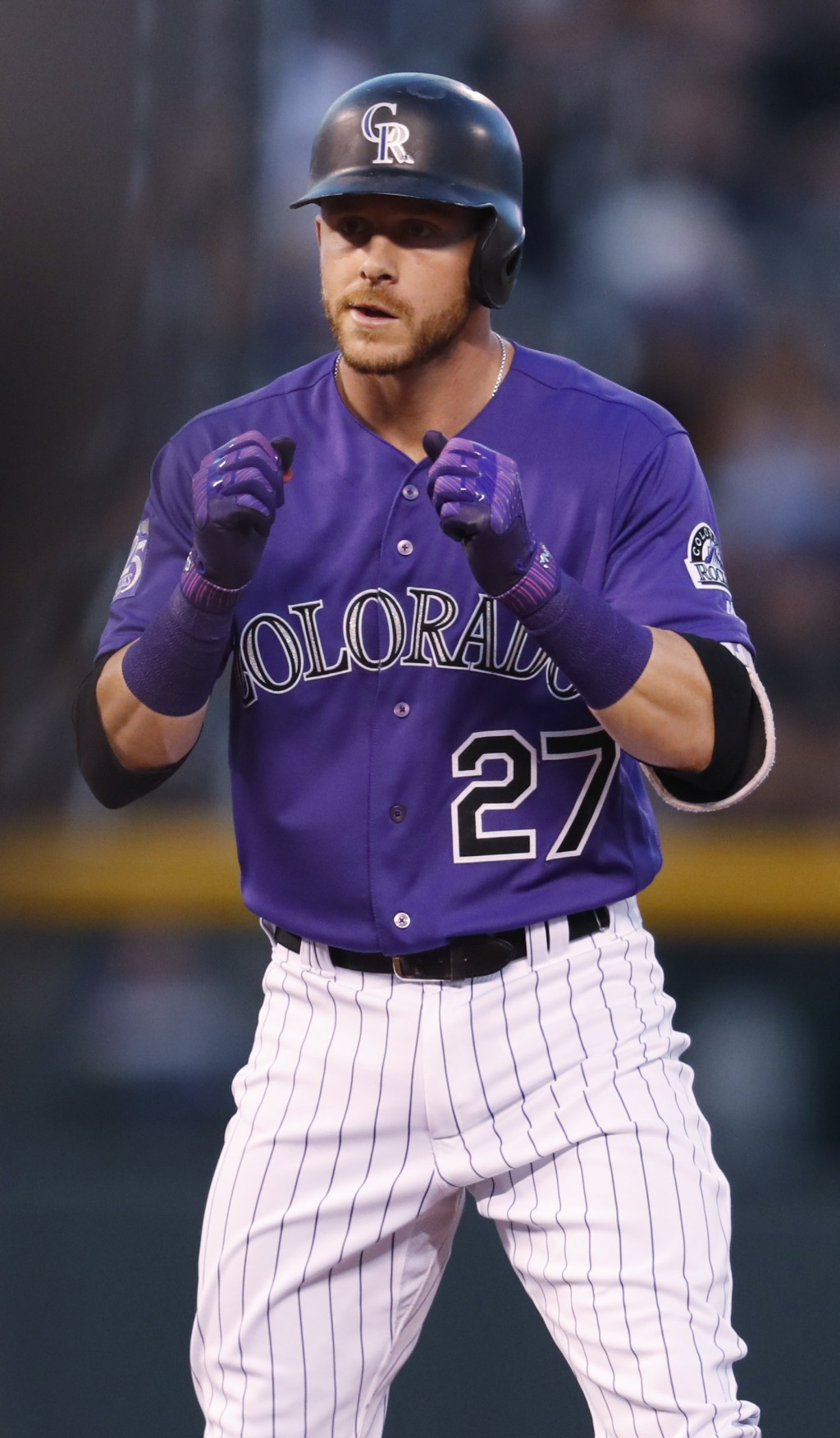 Colorado Rockies' Trevor Story reacts after his RBI-double off Arizona Diamondbacks starting pitcher Zack Greinke in the first inning of a baseball ga