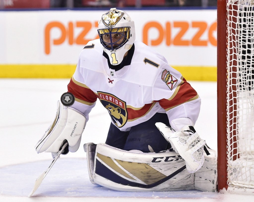 FILE - In this March 28, 2018, file photo, Florida Panthers goaltender Roberto Luongo watches the puck as a shot goes by the net during the second per
